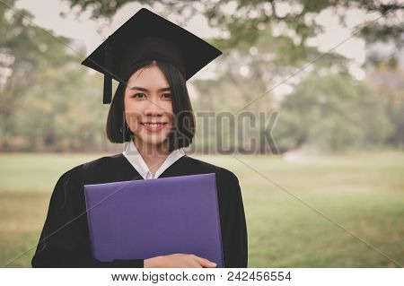 Graduation Concept. Graduated Students On Graduation Day. Asian Students Are Smiling Happily On The