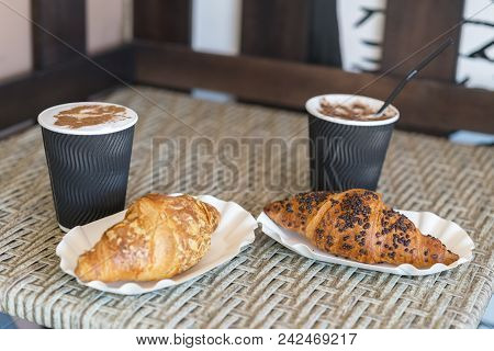 Cappuccino With Croissant. Two Cups Of Coffee With Milk Foam Stands On A Table In Cafeteria. Two Cup