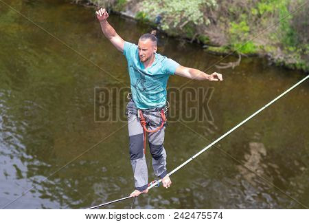 Dnipro, Ukraine - May 06, 2018:young Rope-walker Keeping Balance On A Rope Over Dnipro River In Cent