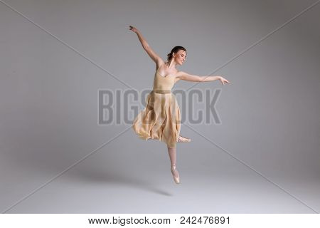 As Light As A Feather! Young Attractive Graceful Gentle Ballerina Dancing In The Art Performance On