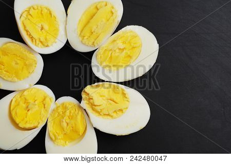 Hard Half Boiled Eggs, Sliced In Halves Food Ingredient Preparation Black Background Isolated