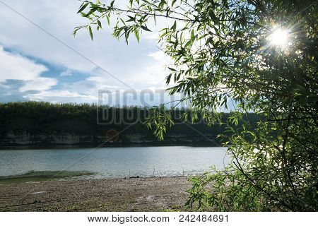 Beautiful River Landscape. Calm River With Colorful Sky Reflection On It. River Flow On Sunset