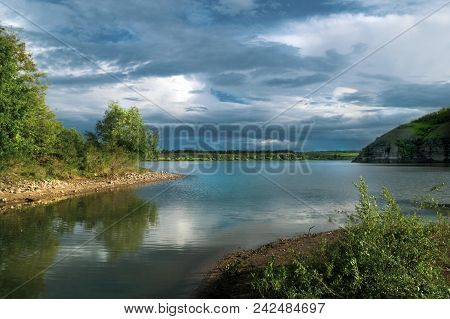 Fantastic River Landscape With Colorful Cloudy Sky