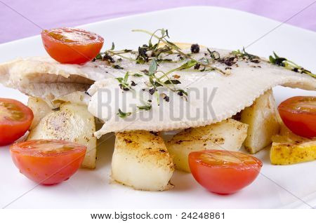 Fresh Fried Plaice With Roasted Potatoes And Tomatoes