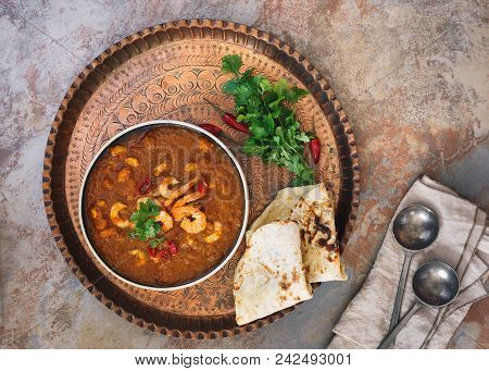 Prawn Curry Shrimp Masala Garnished With Cilantro, Served With Naan Bread On Vintage Copper Tray. To