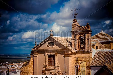 Old Spanish Church On The Hill. Numerous Cottony Clouds Cover The Sky.