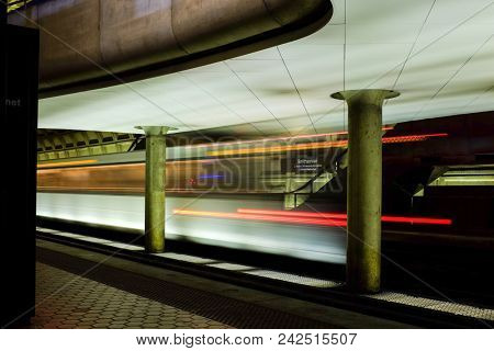Washington DC - Metro station with motion blurred passengers and the train