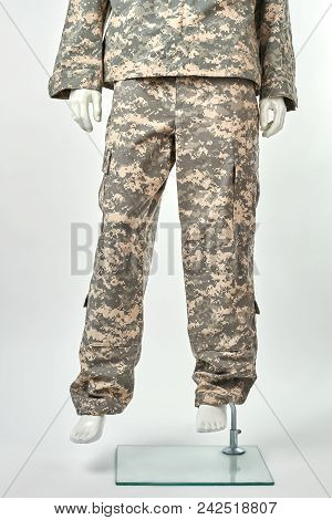 Feet Of Mannequin In Military Uniform. White Isolated Background.