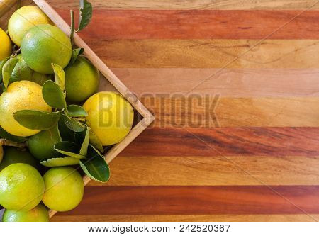 Key Lime Or Mexican Lime In A Wooden Box On Floor, One Of Main Ingredient Thai Food And Traditional