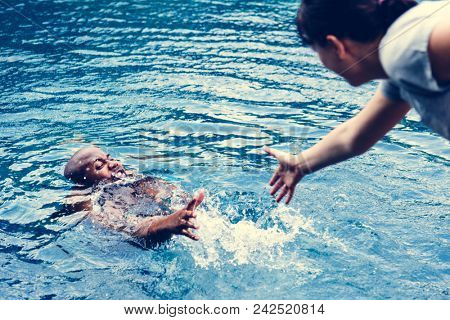 Man being rescued from the water