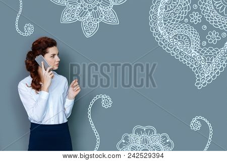 Serious Woman. Calm Professional Lawyer Wearing Elegant Clothes And Looking Serious While Talking On