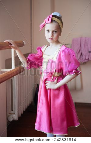 Beautiful Little Russian Girl In Traditional Costume Making Barre Exercise In Ballet School