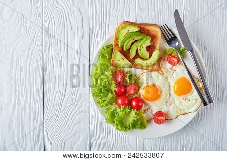 Fried Eggs, Fresh Salad, Toast On A Plate