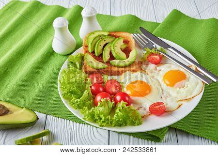 Eggs, Fresh Salad, Toast With Yeast Spread