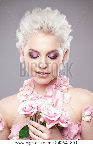 Photo Of A Beautiful Blond Woman With Flower. Closeup Attractive Sensual Face Of White Woman With Cu