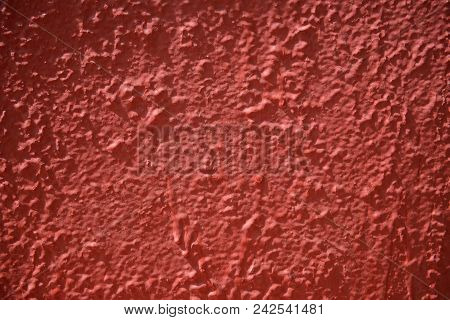 Inaccurately Painted Red Surface With Stains Of Paint