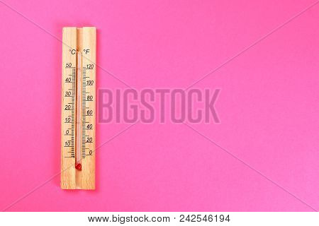 A Wooden Thermometer Showing 30-40 Degrees Of Heat On A Pink Pastel Background. Summer. Top View. Fl