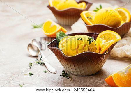 Orange Ice Cream. Summer Orange Sorbet. Homemade Orange Ice Cream With Thyme And Orange Slices