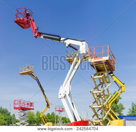 Fragment Of Top Parts Different Self Propelled Articulated Boom Lifts And Scissor Lifts On Backgroun