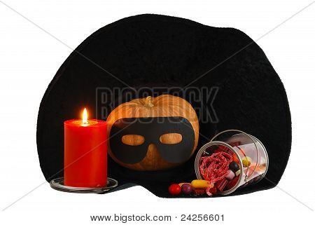 Halloween Candies With Candle And  Pumpkin In Witch Hat Isolated