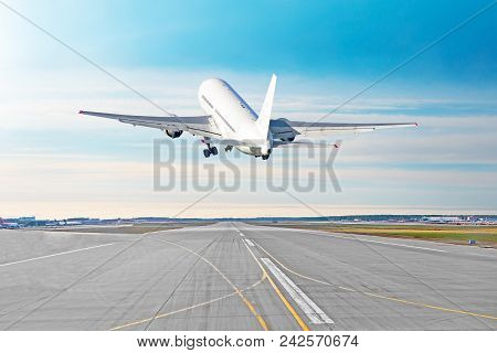 Airplane Flying Departure Take Off On A Runway Airport Good Weather With A Blue Sky Clouds On A Runw