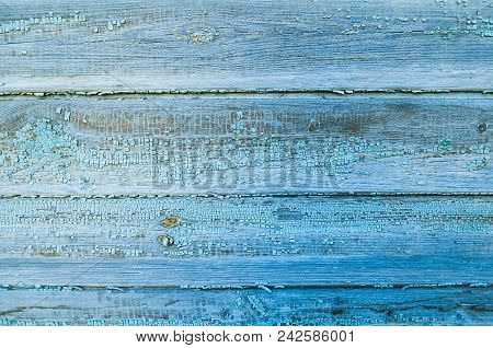 Textured Wooden Background - Wooden Planks Covered With Old Peeling Paint Of Blue Color. Closeup Of