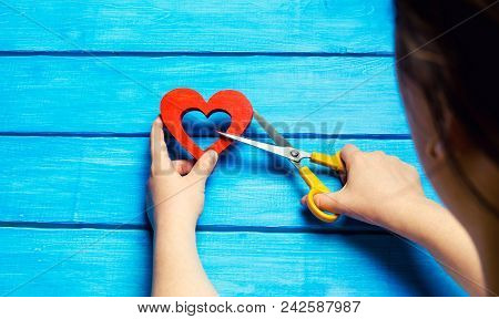 Girl Cuts The Heart With Scissors, The Concept Of Breaking Relations, Quarrels And Divorce. Betrayal