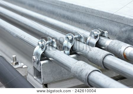 Electrical Conduit With Clamp Installation On Roof