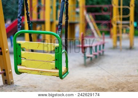 Empty Swings On The Playground, Remind Of Childhood Memories
