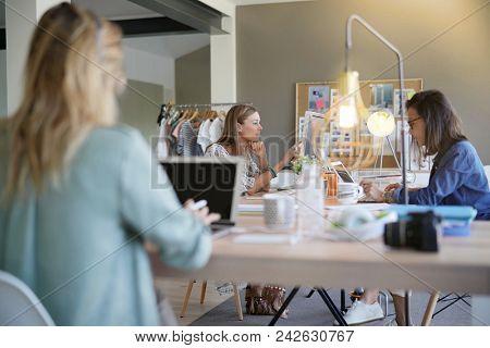 Businesswomen working in co-working space