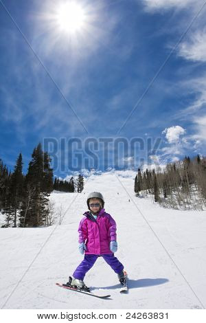 Young Skier skiing down a perfect ski run