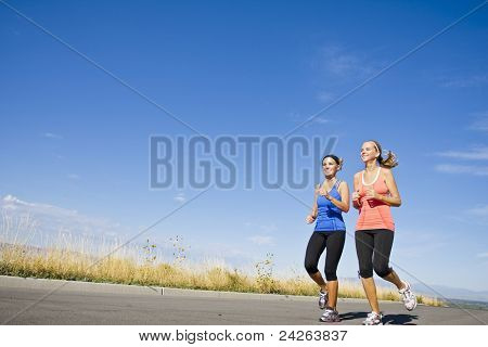 Two beautiful women on morning run outdoors
