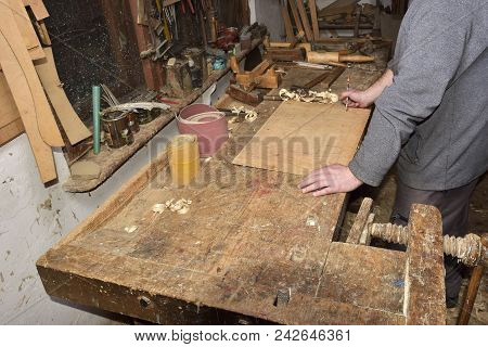 Carpenter working. Carpenter tools on wooden table with sawdust. Carpenter workplace poster