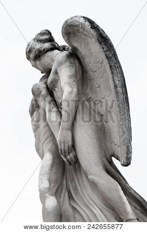 Angels Fly: Stone Sculpture Of Angel Hugging Man, France