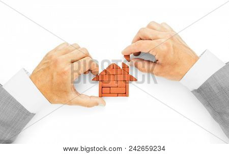 Metaphor of building a house, the last brick, completion of works.