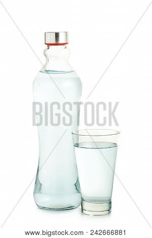 Glass And Bottle Of Water Isolated On White