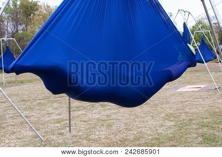 Atlanta, Ga - April 2018:  A Young Woman Lies Suspended In A Cocoon Of Fabric Attached To Poles, As