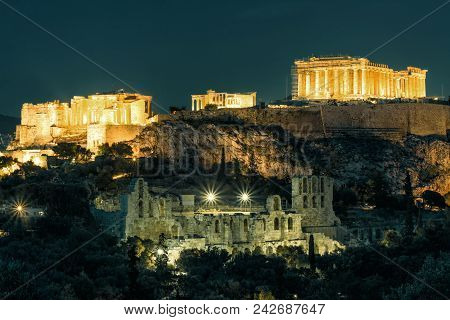 Night View Of The Acropolis, Athens, Greece. Ancient Greek Structures On Acropolis Are The Main Land