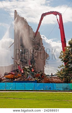 Demolition of the building by a large machine building.