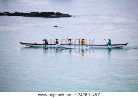 May 16, 2018 In Hilo, Hi:  Group Of Men Participating In The Sport Of Rowing Taken In Hilo, Hi Where