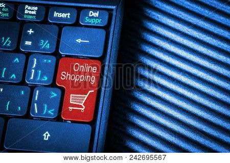Close Up Of Computer Laptop Keyboard With Red Button Online Shopping Concept And Copy Space. Idea Of