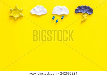 Weather Forecast Concept. Modern Weather Icons Set On Yellow Background Top View.