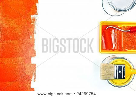Painting Tools On White Surface With Paint Strokes. Paint Tins, Roller And Paint Brush Flat View