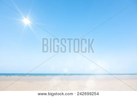Blurred Cool Sea And Sunlight With Tropical Sandy Beach On Background
