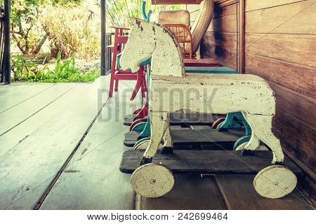 Vintage Rocking Hourse In Old House. Old Rustic Toy In Wooden House