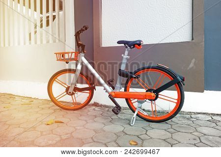 Modern Two-wheeled Bicycle Indoors Near Wall In Morning