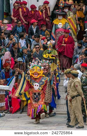 Leh, India - June 21, 2017: Unidentified monks in mask performing a religious masked and costumed mystery dance of Tibetan Buddhism during the Buddhist festival at Hemis monastery, Ladakh.