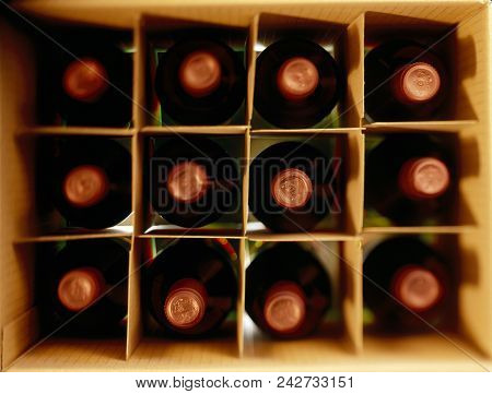 A Box Of Red Wine Bottles Shot From Above, With Tilt Shift Focus.