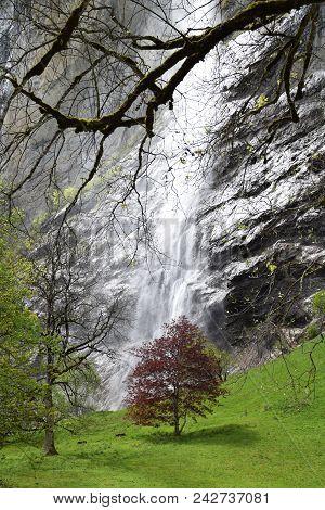 Huge Waterfall In Lauterbrunnen Village In Switzerland