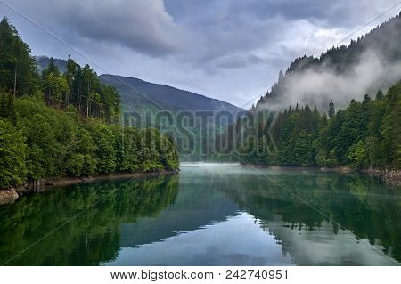 Lake In The Mountains On A Foggy Day